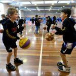 Kids learning basketball at Girl playing basketball at School holiday basketball program July 2019