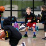 Kids playing basketball at School holiday basketball program July 2019
