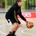 Boy playing basketball at School holiday basketball program July 2019