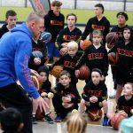 Brett Rainbow giving basketball training at Girl playing basketball at School holiday basketball program July 2019