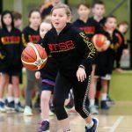 Girl playing basketball at School holiday basketball program July 2019