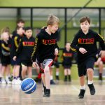 Kids playing basketball - School holiday basketball program July 2019