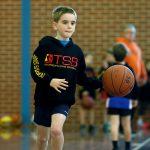 A boy playing basketball - School holiday basketball program July 2019