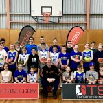 Brett Rainbow with kids at Girl playing basketball at School holiday basketball program July 2019