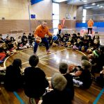 Brett Rainbow teaching basketball lessons to kids at School holiday basketball camp July 2019