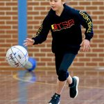 Girl playing basketball at School holiday basketball camp July 2019