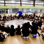 Brett Rainbow giving basketball lessons to kids at School holiday basketball camp July 2019