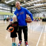 Brett rainbow with a girl at School holiday basketball camp July 2019