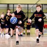 Kids playing basketball - School holiday basketball camp July 2019