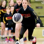 Girl playing basketball in school holiday basketball camp - July 2019