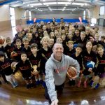 Brett Rainbow taking selfie with kids at Girl playing basketball at School holiday basketball program July 2019