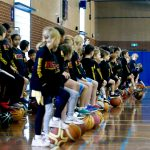 Brett Rainbow with kids at school holiday basketball camps - July 2019