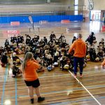 Brett Rainbow with his team giving basketball lessons to kids at School holiday basketball camp July 2019